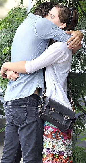 Johnny Simmons puts his arms around Emma Watson