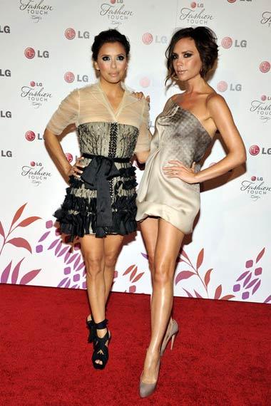 Eva Longoria and Victoria Beckham posing