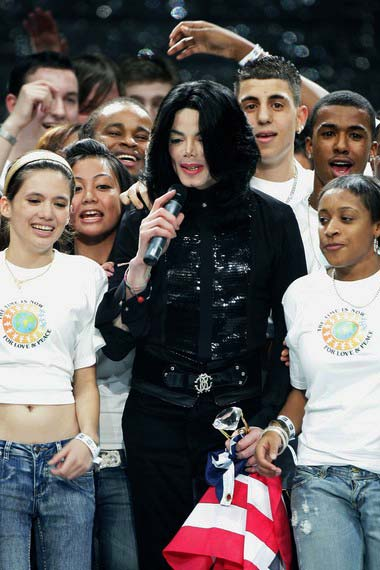 Michael Jackson surrounded by fans