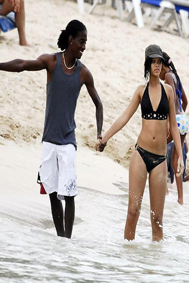 Rihanna hand in hand with Negus