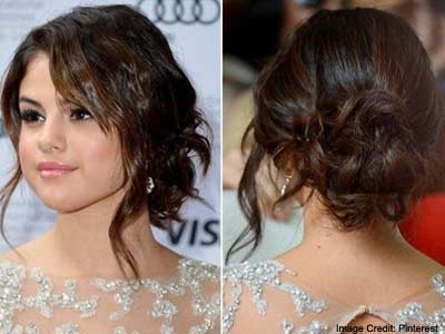 Wavy Loose Bun with side Bangs Hairstyle