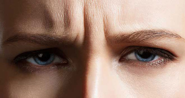 Frown Lines Form Between Eyebrows